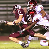 Logan Cook, of Woodrow Wilson, left, is tackled by Derrick Blevins, 2, and Jahim House, 10, of Bluefield, during second quarter action Friday night at Van Meter Stadium in Beckley.<br /> (Rick Barbero/The Register-Herald)
