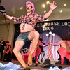 (Brad Davis/The Register-Herald) Participant Luke Begovich performs during individual introductions at the annual Hunks in Heels fundraising event for the Women's Resource Center Friday night at the Beckley Moose Lodge.