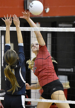 (Brad Davis/The Register-Herald) PikeView's Laken McKinney spikes the ball during a volleyball match against Nicholas County at Liberty High School October 11.