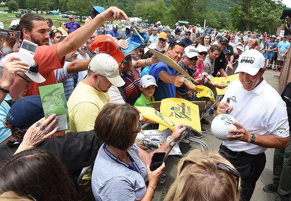 Phil Mickelson sign autographs after the third round of The Greenbrier Classic.<br /> (Rick Barbero/The Register-Herald)