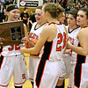 (Brad Davis/The Register-Herald) The Lady Bobcats collect their trophy after defeating Fayetteville in the Class A Region Three championship game Thursday night in Hinton, punching Summers County's ticket to next week's state tournament in Charleston.