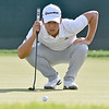 (Brad Davis/The Register-Herald) Greenbrier Classic winner Xander Schauffele eyeballs his eventual clinching birdie putt on #18 during final round Greenbrier Classic action Sunday afternoon in White Sulphur Springs.