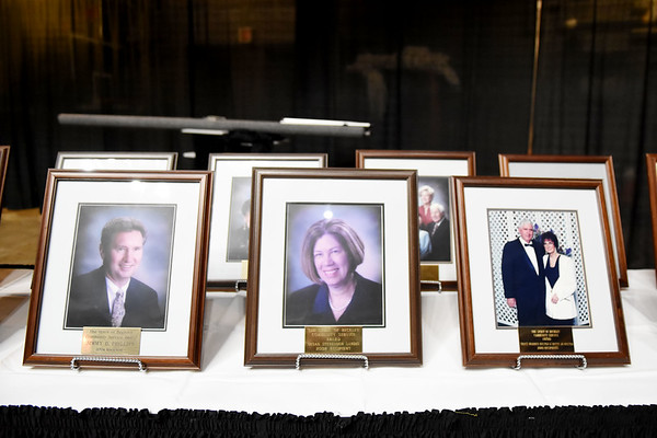 Photos displaying some of the past recipients of the Spirit of Beckley Award during the 31st annual Spirit of Beckley Award at the Beckley-Raleigh County Convention Center in Beckley on Monday. (Chris Jackson/The Register-Herald)
