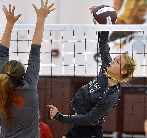 (Brad Davis/The Register-Herald) Independence's Destiny Blankenship spikes the ball against Cabell Midland during the Shirley Brown Invitational Volleyball Tournament Saturday afternoon at Woodrow Wilson High School.