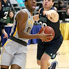 (Brad Davis/The Register-Herald) WVU Tech's Thomas Collins charges to the basket past Mount Vernon Nazarene's Jay Joseph Tuesday night at the Beckley-Raleigh County Convention Center.