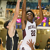 (Brad Davis/The Register-Herald) Woodrow Wilson's Isaiah Francis soars to the basket as University's Clay Bailey defends during Big Atlantic Classic action Saturday night at the Beckley-Raleigh County Convention Center.