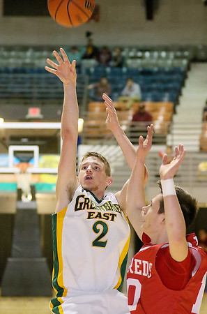 (Brad Davis/The Register-Herald) Greenbrier East's Seth Brown gets a shot away before Parkersburg's Seth Dailey can stop him during Big Atlantic Classic action Saturday night at the Beckley-Raleigh County Convention Center.