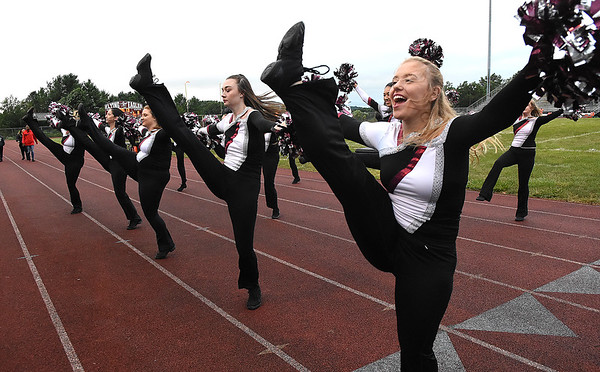 Alex Bailey, right, and her Lassie teammates from Woodrow Wilson perform during game against Greenbrier East Friday night at Van Meter Stadium in Beckley.<br /> (Rick Barbero/The Register-Herald)