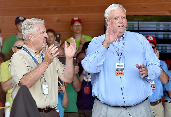 (Brad Davis/The Register-Herald) Governor Jim Justice waves as he's introduced durng opening ceremonies for visiting United States Secretary of State Rex Tillerson Friday at the Bechtel Summit Reserve.