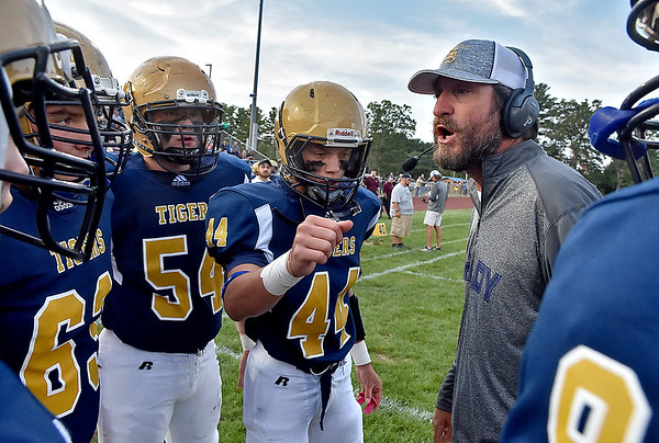 (Brad Davis/The Register-Herald) Shady Spring head coach Vince Culicerto gets his squad fired up prior to the start of the Tigers' game against Lincoln County Friday night in Shady Spring.