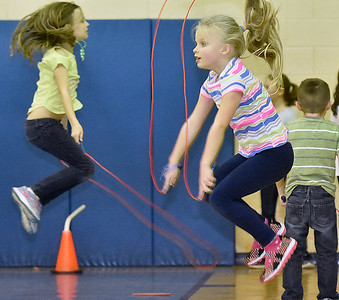 (Brad Davis/The Register-Herald) Kindergartener Lilly Church, right, jumps rope with her classmates during Maxwell Hill Elementary's Jumping for Hearts event Friday afternoon in the school's gymnasium. Students spent several days gathering donations for the American Heart Association by sending out e-mails, asking friends and family or even going door-to-door in their neighborhoods if they wished, raising around $5,000 overall. The annual event concluded with a special celebration in the gym where students got to run and play in a variety of jumping-related activities.