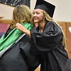(Brad Davis/The Register-Herald) Summers County High School graduate Brittney Justice gets a hug from principal Kari Vicars during the school's commencement ceremony Friday evening in Hinton.