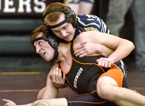 (Brad Davis/The Register-Herald) Shady Spring's Tyler Worrells takes on Richwood's Marshal Pomeroy in a 160-pound weight class matchup during the Raider Rumble Saturday afternoon in Glen Daniel. Shady's Worrells would win the match.