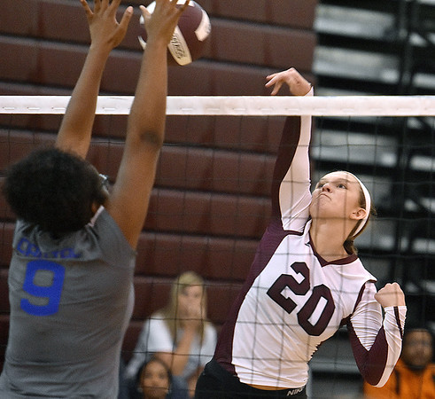 (Brad Davis/The Register-Herald) Woodrow Wilson's Adrian Coalson hits the ball as Capital's Diarrah Gibson tries to block it during the Shirley Brown Invitational Volleyball Tournament Saturday afternoon at Woodrow Wilson High School.