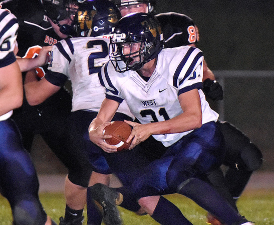 (Brad Davis/The Register-Herald) Greenbrier West's Chad Ramsey carries the ball Friday night in Hinton.