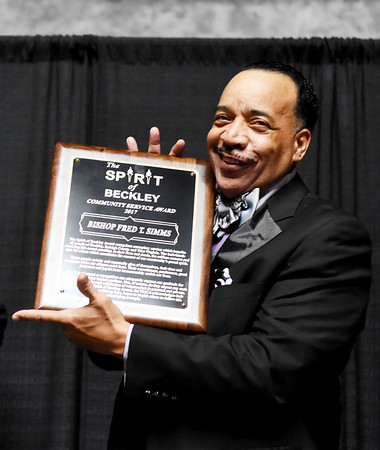 Bishop Fred T. Simms with the Spirit of Beckley Award  during the 31st annual Spirit of Beckley Award at the Beckley-Raleigh County Convention Center in Beckley on Monday.  (Chris Jackson/The Register-Herald)
