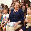 First Lady Cathy Justice, third from left, sits on the front row with, Brooklyn Boggs, left, Jayden Vandall, Adam Robinson and Katelyn Rogers during her visited at the Rainelle Elementary Energy Express site to promote summer reading and nutrition. During her visit, she read to the students and encourage them to read every day during the remainder of their summer break.<br /> (Rick Barbero/The Register-Herald)