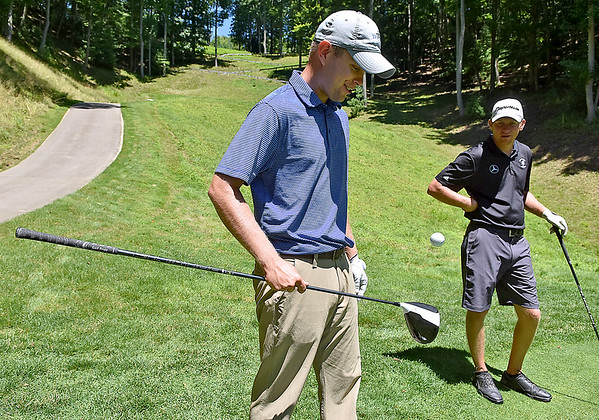 (Brad Davis/The Register-Herald) Groupmate Tony Giles, right, looks on as Brandon Reece shows off some skills and bounces a ball on his club continuosly during BNI action Sunday afternoon at Glade Springs' Stonehaven Golf Course.