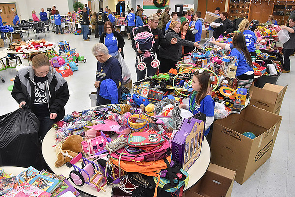 (Brad Davis/The Register-Herald) Shoppers browse thousands upon thousands of items during the Wyoming County Toy Fund Sunday morning at Wyoming East High School.