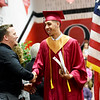 Tyrese Selinger is congratulated by Oak Hill Vice Principal Chad Quesenberry during the Oak Hill High School 2017 Commencement in Oak Hill on Friday. (Chris Jackson/The Register-Herald)