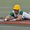 (Brad Davis/The Register-Herald) Miners baserunner Dan Ward dives in to steal 3rd base before Kokomo infielder Storm Joop can tag him Friday night at Linda K. Epling Stadium.