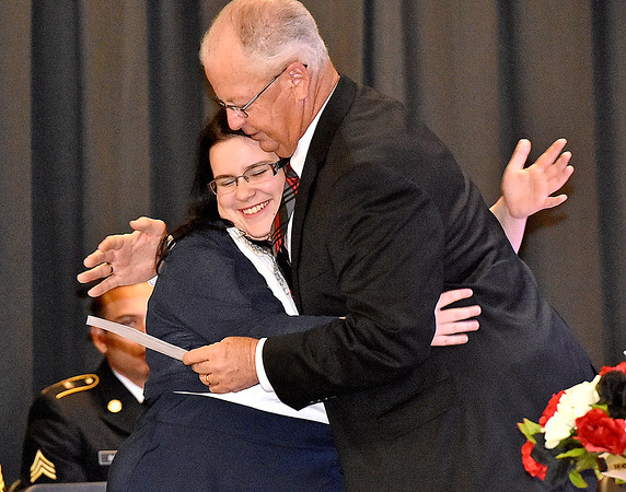 (Brad Davis/The Register-Herald) Liberty High School senior McKenzie Simpson gets a hug as she accepts one of her scholarship awards during the school's Senior Awards Assembly Monday evening in Glen Daniel.