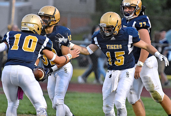 (Brad Davis/The Register-Herald) Shady Spring's Tyler Bragg is congratulated by teammates after scoring a touchdown against Lincoln County Friday night in Shady Spring.
