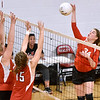(Brad Davis/The Register-Herald) Greater Beckley Christian's Lydia Jordan, right, spikes the ball as Ravenswood's Katie Mellinger, left, and Kasey Hoff try to block it Saturday afternoon in Prosperity.