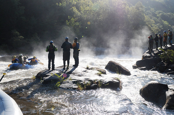 Rafters and kayakers watch as a raft group navigates the Pillow Rock rapids on the 2017 opening day of Gauley Season Friday.  (Chris Jackson/The Register-Herald)