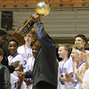 (Brad Davis/The Register-Herald) Beckley-Stratton head coach Jaron Jones hoists the trophy after the Bulldogs took the Big Atlantic Classic boys middle school championship game over Mullens Wednesday afternoon at the Beckley-Raleigh County Convention Center.
