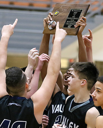 (Brad Davis/The Register-Herald) The Valley Greyhounds celebrate with the hardware after earning a trip to Charleston with a win over Greater Beckley Christian in the Region 3 Co-Final Thursday night at the Beckley-Raleigh County Convention Center.