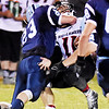 Meadow Bridge's Nicholas White (23) tackles Webster County's Reece Nutter (11) during their high school football game Friday in Meadow Bridge. (Chris Jackson/The Register-Herald)