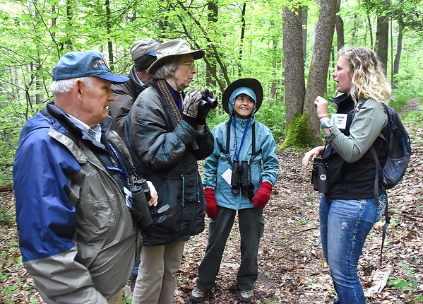 Mollee Brown, guide from FAirmont, right, talk to bird watches using sign language during a guided during the New River Birding and Nature Festival.<br /> (Rick Barbero/The Register-Herald)