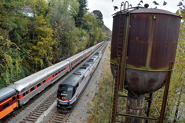 (Brad Davis/The Register-Herald) The Amtrak engine that hauls the New River Train Excursion makes its way back to the other side of the historic train cars after turning around for its return trip to Huntington during Hinton Railroad Days Sunday afternoon.