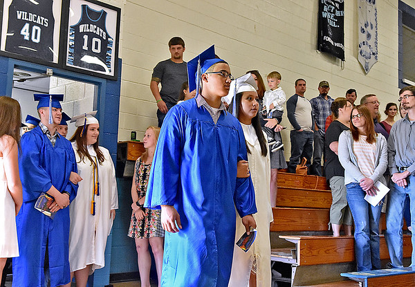 (Brad Davis/The Register-Herald) Graduating seniors make their way into the gym during the opening moments of Meadow Bridge High School's 2017 commencement ceremony Saturday afternoon.