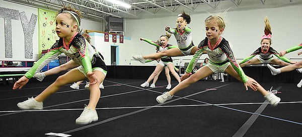 GymFinity All-Star team, Cosmo's preparing for compitition at GymFinity in Oak Hill. <br /> (Rick Barbero/The Register-Herald)