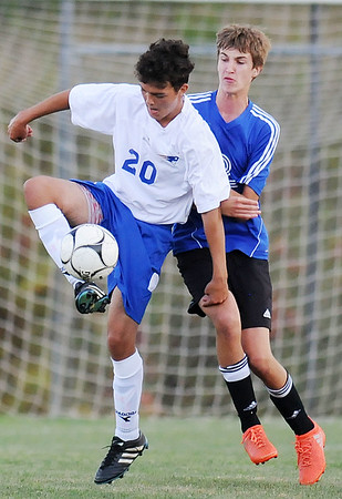 Independence's (20} defends against Mercer Christian's (2) during their soccer match Tuesday in Beckley. (Chris Jackson/The Register-Herald)