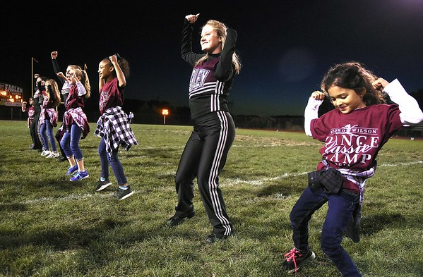 Woodrow Wilson Lassie Dance Campers performed along side with the Woodow Lassie's before the start of the game against Huntington Friday night at Van Meter Stadium in Beckley.<br /> (Rick Barbero/The Register-Herald)