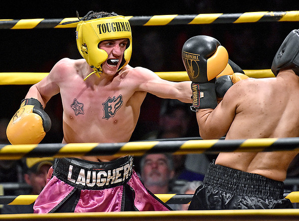 (Brad Davis/The Register-Herald) Oak Hill's Robert Laughery, left, takes on Ronaldo Dominguez in a lightweight matchup during Original Toughman action Saturday night at the Beckley-Raleigh County Convention Center. Laughery would win the fight.