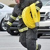 (Brad Davis/The Register-Herald) Rhodell Volunteer Firefighter Fred Shrewsbury runs a fire hose from point A to B as quickly as possible during the obstacle course portion of a Raleigh County Firefighter Day event geared towards a mixture of showcasing firefighter tactics and attracting needed volunteers to several departments around the county Sunday afternoon at the Crossroads Mall.