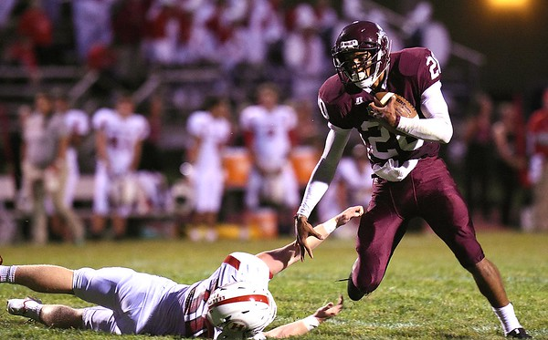 Micah Hancock. of Woodrow Wilson, right, breaks away from, Cameron Kimble, of Hurricane, for some extra yards Friday night at Van Meter Stadium in Beckley.<br /> (Rick Barbero/The Register-Herald)