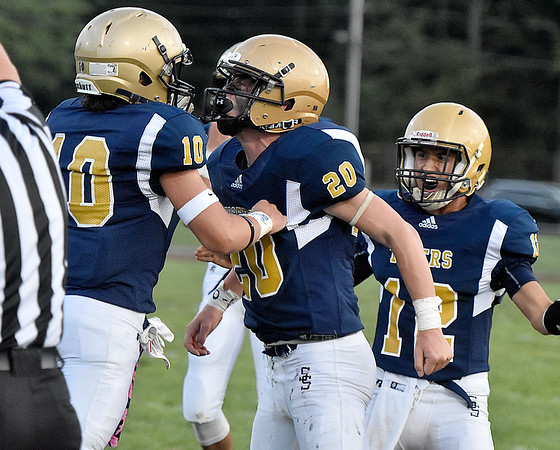 (Brad Davis/The Register-Herald) Shady Spring defenders react after making a big stop against Lincoln County Friday night in Shady Spring.