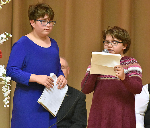 (Brad Davis/The Register-Herald) 12-year-old Cheyenne Miller, left, and 10-year-old Dakota Keir read a short essay on what the flag means to them during Fayetteville's annual Veteran's Appreciation Day ceremony at the Fayette County Soldier's and Sailor's Memorial Building Sunday afternoon.
