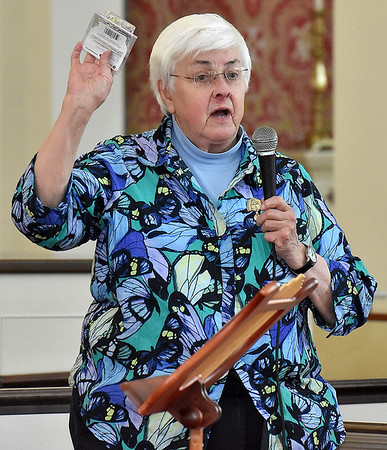(Brad Davis/The Register-Herald) Joan C. Browning, one of the Albany (Georgia) Freedom Riders from the civil rights struggles of 1960's, speaks during a vigil for peace and unity at St. Stephens Episcopal Church Wednesday night.