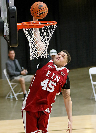 (Brad Davis/The Register-Herald) WVU recruit Teddy Allen dunks during the Scott Brown memorial game Saturday evening at the Beckley-Raleigh County Convention Center.