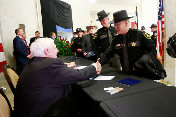 Governor Jim Justice shakes hands with Fayette County Sheriff Michael Fridley during a receiving line following his inauguration as the 36th Governor of the State of West Virginia at the Capitol in Charleston on Monday. (Chris Jackson/The Register-Herald)