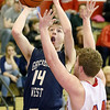 (Brad Davis/The Register-Herald) Greenbrier West's Landon Humphreys drives and scores as Independence's Dylan Dickens defends Wednesday night in Coal City.