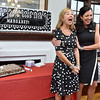 (Brad Davis/The Register-Herald) Outgoing United Way of Southern West Virginia executive director Magaret Ann O'Neal, left, is honored by Michelle Rotellini, who is taking her place, during a special sendoff celebration for her at the organization's Croft Street location Friday afternoon.