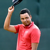 (Brad Davis/The Register-Herald) Sebastian Munoz acknowledges the crowd as he makes his way onto the #18 green during first round Greenbrier Classic action Thurdsay afternoon in White Sulphur Springs.