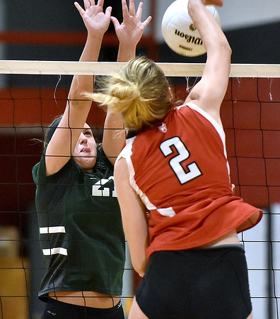 (Brad Davis/The Register-Herald) Fayetteville's Whimzey Gipson leaps to try to block a spike from Ravenswood's Skylar Mace Saturday afternoon in Prosperity.